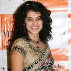 Curly hair beauty Tapsee in Saree