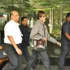 Big B Snapped at Airport In Green Florescent Sports Shoes