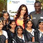 Bipasha Basu Poses With Students Of A School During A Function