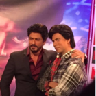 Shah Rukh poses with his wax statue, which has been re-dressed as Gaurav from Fan