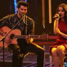 Aditya Roy Kapur and Shraddha Kapoor singing live on a stage