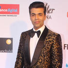 Karan Johar gets measured for his wax figure