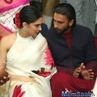 Sweet hubby Ranveer Singh carries Deepika Padukone's footwear at a wedding