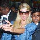 Paris Hilton Taking a Snap Using Her iPhone in Mumbai