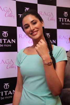 Nargis Fakhri Shows The Watch At Titan Raga Cities Collection Launch