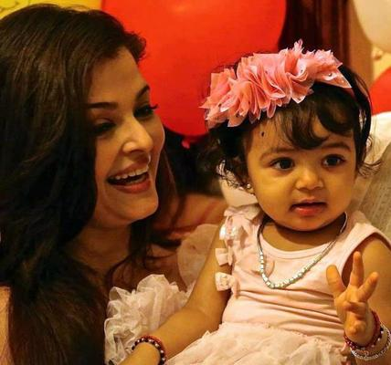 Aaradhya With Mom Aishwarya Nice Look With Cute Smiling Photo On Her First Birthday