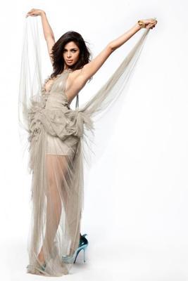 Mallika Sherawat Sizzling Photo Still In White Transparent Dress