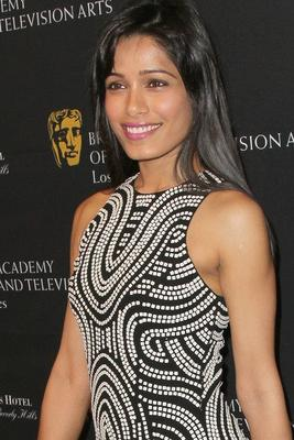 Freida Pinto Fashes A Smiling Pose At Bafta Tea Party 2013