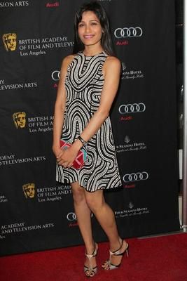 Freida Pinto Walks In Red Carpet At Bafta Tea Party 2013