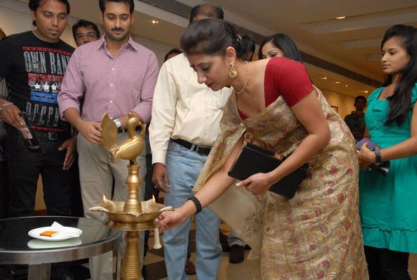 A Celeb Guest Lights The Candle And Uday Kiran Looks On At Tribal Beauty Art Exhibition Launch Event