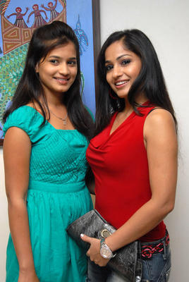 Madhavi Latha Smiling Pose At Tribal Beauty Art Exhibition Launch Event