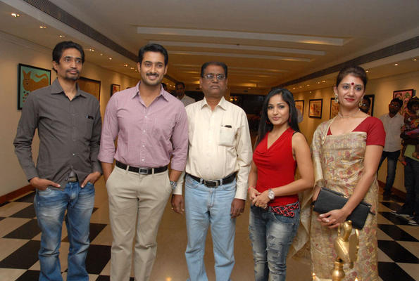 Uday Kiran And Madhavi Latha Posed For Camera At Tribal Beauty Art Exhibition Launch Event