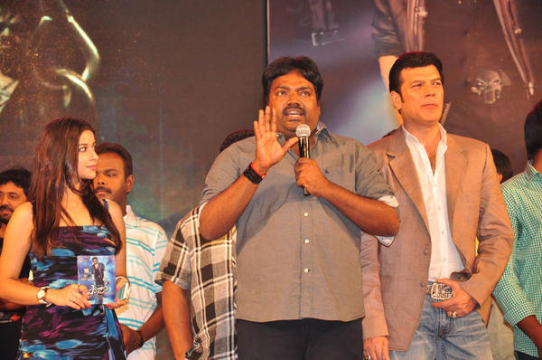 Meher Ramesh peaks Out Photo Clicked At Shadow Movie Audio Release Function
