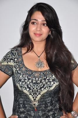 Charmy Complete Her Look With Flowing Hair Photo Still At  Prema Okamaikam Audio Launch