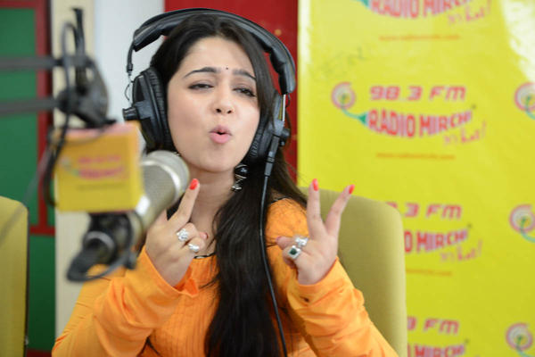 Charmy Kaur Rocking Still During The Promotion Of Prema Oka Maikam Movie At Radio Mirchi Station