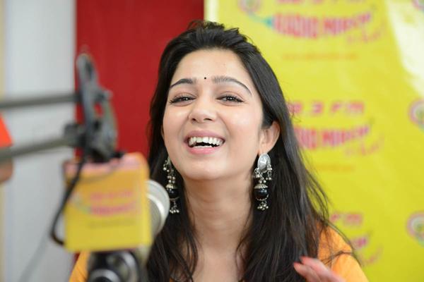 Charmy Kaur Smiling Still During The Promotion Of Prema Oka Maikam Movie At 98.3 FM