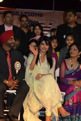 Priyanka Smiling Look With Waving Hands For Fans During The India Day Parade 2013 In LA