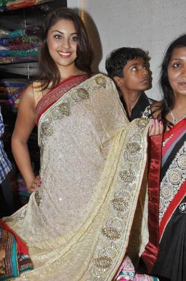Richa Gangopadhyay Shows A White Saree To The Camera During The Launch Of Priyanka Showroom At Hyderabad