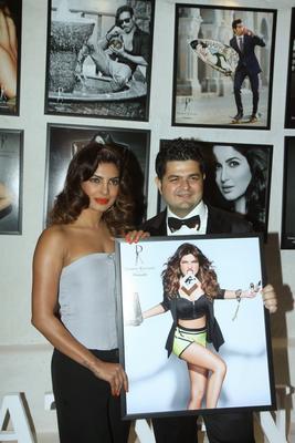 Priyanka And Dabboo Pose Priyanka's Poster At His 2014 Calendar Launch Event