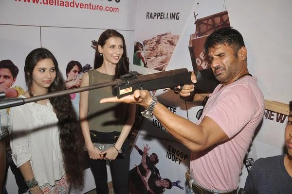 Sunil Posed To Shoot, Claudia And Sasha Look On  At Mumbai Mayor Cup Shooting Competition 2014 During The Promotion Of Desi Kattey
