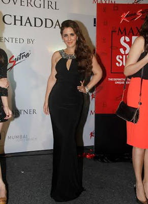 Pria Kataria Puri Hot Look In Black Dress During The Launch Of Maxim Kamasutra Magazine Cover