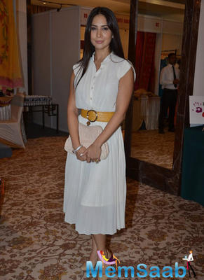 Kim Sharma Poses For The Media At The Helping Hands Exhibition