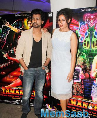 Nikhil Dwivedi And Richa Chadda Strike A Pose For Shutterbug At Film Tamanchey Screening