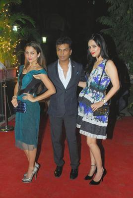 Amrita Arora,Vikram Phadnis And Anu Dewan Posed On Red Carpet During The Launch Of Vikram Phadnis Fashion Store Krasaa