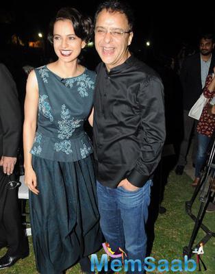 Kangana Ranaut And Vidhu Vinod Chopra Smiling Pose During Anupama Chopra Book The Front Row Launch Event