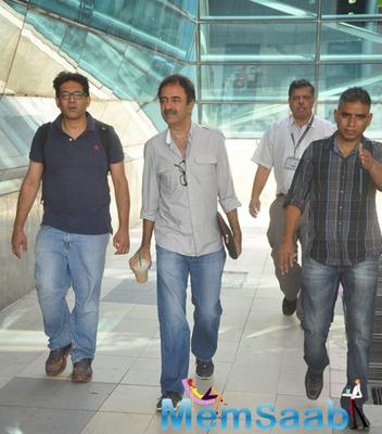 Richa And Rajkumar Hirani Snapped At Airport