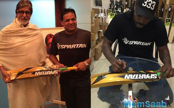 West Indies cricketer Chris Gayle presents his gold bat to Big B