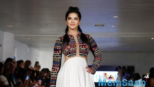 Jism star Sunny Leone walked the ramp at the coveted fashion week and looked resplendent as the showstopper in an ivory Archana Kochhar gown.