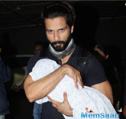 Daddy Shahid keeps baby Misha away from paparazzi at airport