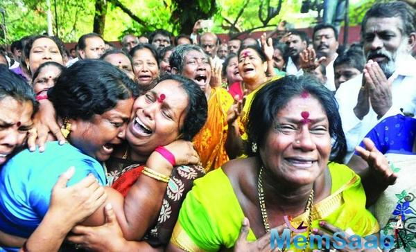 Here fans of  Chief Minister Jayalalithaa reaction outside the hospital after she had died in Chennai on Monday.
