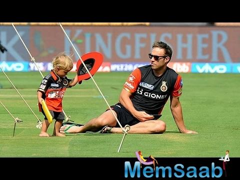 Ab De Villiers cute son saying RCB and playing cricket in stadium