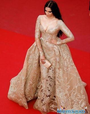 The second appearance of Sonam Kapoor at the ongoing Cannes Film Festival was stunning as she walked the red carpet in a gold Elie Saab gown.