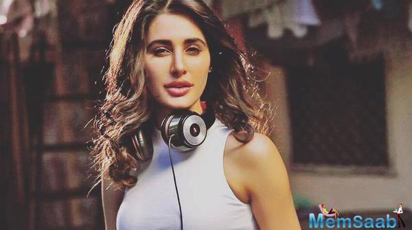 Actress Nargis Fakhri turned Singer, has lent her vocals to a new track featuring Indo-Canadian R&B singer Parichay and Kardinal Offishall.