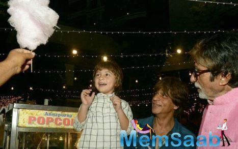 Big-B on Sunday shared pics of some candid moments with junior SRK from granddaughter Aradhya's birthday.