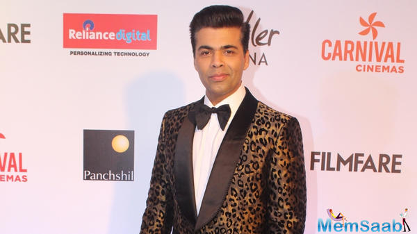 Karan Johar gets measured for his wax figure