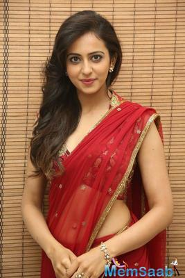 Rakul Preet Singh, who was last seen in Neeraj Pandey's Aiyaary,  says 50 per cent of the shoot of her forthcoming urban romantic comedy film with Ajay Devgn, is complete.