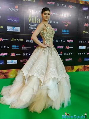 Urvashi Rautela, setting the green carpet on fire with her beautiful gown