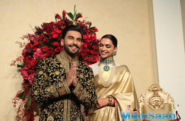 While Deepika and Ranveer look like a dreamy couple, watch the duo walk hand-in-hand as they grace their reception stage.