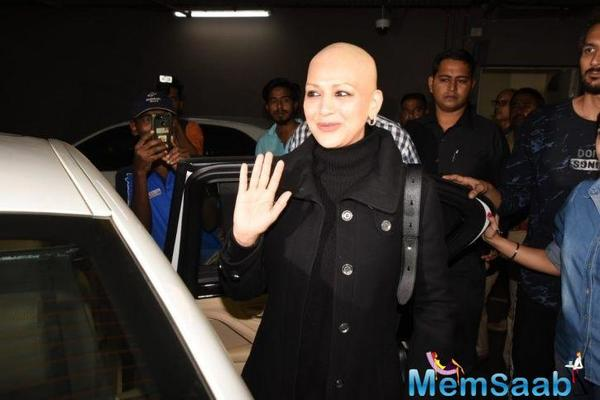 Sonali Bendre returns to India with a glittering smile