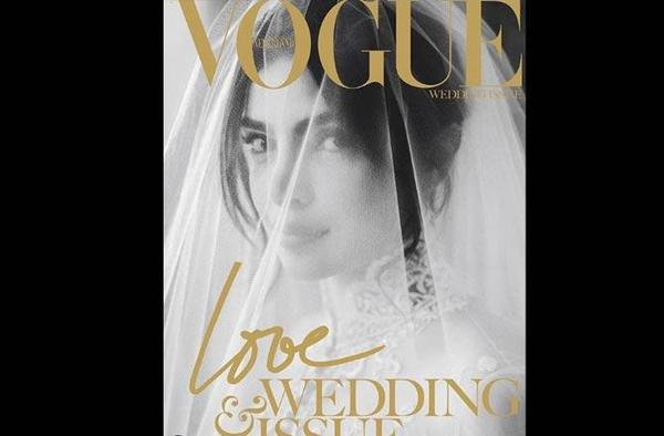 In the picture, Priyanka can be seen wearing her white embroidered Ralph Lauren wedding gown, gazing through her beautiful veil.