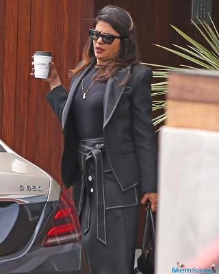 Priyanka can be seen stretching out as she steps out of her car with a cup of coffee in her hand. But there was another thing that caught our attention which was her mangalsutra which looked beautiful on her.