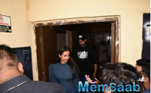 Arjun Kapoor plays the protective boyfriend to Malaika Arora as they make way post IMW's screening