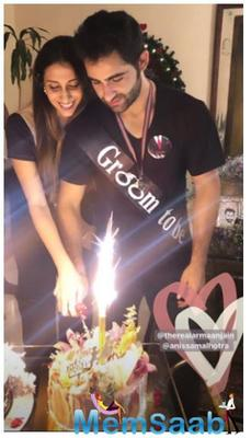 In the picture, we can see Armaan on his knees proposing to Anissa in at a plush hotel. Armaan looks dapper in a black jacket and black pants while Anissa looks beautiful in her black floral dress.