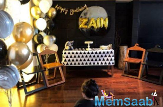 Finally, the last image is of the birthday boy, Zain overlooking at the preparations done by mommy dearest. Although all this is cute, Zain Kapoor's ponytail is cutest!