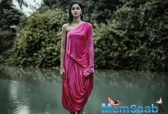 Taking to her Instagram handle, Ananya shared the viral picture where she can be seen donning a shocking pink one-shoulder dress that clung to her after she drenched herself in the falling rain.