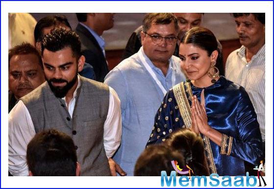 Pics: Anushka Sharma, Virat Kohli steal romantic moments at Delhi event